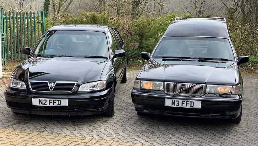 Friendship and sons funeral cars parked